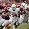 Texas quarterback David Ash tries to outrun the OU defense during the Sooners\' 63-21 win two seasons ago in Dallas. PHOTO BY CHRIS LANDSBERGER, THE OKLAHOMAN
