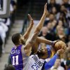 Phoenix Suns\' Markieff Morris (11) defends as Dallas Mavericks\' Vince Carter (25) attempts a shot in the first half of an NBA basketball game, Sunday, Jan. 27, 2013, in Dallas. (AP Photo/Tony Gutierrez)