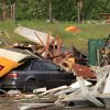 A car in the parking lot of Love\'s store south of Interstate 40 at Choctaw Rd., is covered with debris from the building\'s storefront and awning, Monday evening, May 10, 2010. Photo by Jim Beckel, The Oklahoman