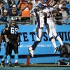 Photo -   Denver Broncos' Tony Carter, center, celebrates with teammate Chris Harris, right, as Carolina Panthers' Jordan Gross, left, looks on after Carter's touchdown during the second half of an NFL football game in Charlotte, N.C., Sunday, Nov. 11, 2012. (AP Photo/Rainier Ehrhardt)