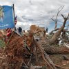 A tattered Oklahoma flag waves outside the home of Charles and Susan Sleeper where there home was destroyed by Tuesday\'s tornado west of El Reno, Wednesday, May 25, 2011. Photo by Chris Landsberger, The Oklahoman