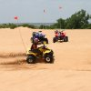 Riders take on the 70-foot sand dunes on their ATVs at Little Sahara State Park. PHOTO PROVIDED.