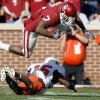 OU\'s DeMarco Murray (7) leaps over OSU\'s Perrish Cox (16) during the first half of the Bedlam college football game between the University of Oklahoma Sooners (OU) and the Oklahoma State University Cowboys (OSU) at the Gaylord Family-Oklahoma Memorial Stadium on Saturday, Nov. 28, 2009, in Norman, Okla. Photo by Sarah Phipps, The Oklahoman