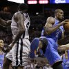 Oklahoma Thunder\'s Serge Ibaka (9) pulls down a rebound in front of San Antonio Spurs\' DeJuan Blair, left, during the second quarter of an NBA basketball game, Thursday, Nov. 1, 2012, in San Antonio. (AP Photo/Eric Gay) ORG XMIT: TXEG104