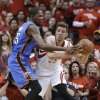 Houston Rockets\' Chandler Parsons (25) looks to pass the ball around Oklahoma City Thunder\'s Kevin Durant (35) in the second quarter of Game 6 in a first-round NBA basketball playoff series Friday, May 3, 2013, in Houston. (AP Photo/Pat Sullivan)
