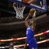 Photo - Philadelphia 76ers' Thaddeus Young, right, goes up for a dunk against Detroit Pistons' Josh Smith during the first half of an NBA basketball game on Saturday, March 29, 2014, in Philadelphia. (AP Photo/Matt Slocum)