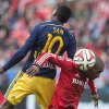 Photo - Toronto FC 's Jermain Defoe, right, battles for the ball with New York Red Bulls' Lloyd Sam  during the first half of an MLS soccer game in Toronto on Saturday, May 17, 2014. (AP Photo/The Canadian Press, Chris Young)