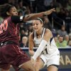 Photo - Notre Dame guard Kayla McBride, right, throws a pass around Virginia Tech forward Nia Evans during the first half of an NCAA college basketball game, Thursday, Jan. 30, 2014 in South Bend, Ind. (AP Photo/Joe Raymond)
