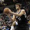 Brooklyn Nets\' Brook Lopez looks to pass in the second half of an NBA basketball game against the Minnesota Timberwolves, Wednesday, Jan. 23, 2013, in Minneapolis. Lopez led the the Nets with 22 points and 7 rebounds in their 91-83 win. (AP Photo/Jim Mone)