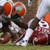 Photo - Oklahoma's Dominique Whaley (8) fumbles the ball beside Florida A&M's Brandon Denmark (8) during the college football game between the University of Oklahoma Sooners (OU) and Florida A&M Rattlers at Gaylord Family-Oklahoma Memorial Stadium in Norman, Okla., Saturday, Sept. 8, 2012. Photo by Bryan Terry, The Oklahoman