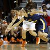 Oklahoma State\'s Brittney Martin (22) and West Virginia\'s Brooke Hampton (4) go for the ball during a women\'s college basketball game between Oklahoma State and West Virginia at Gallagher-Iba Arena in Stillwater, Okla., Tuesday, Jan. 29, 2013. Photo by Bryan Terry, The Oklahoman