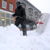 Earl Barnes shovels snow off the sidewalk in front of Smith\'s Market on S. Main St. in Hutchinson, Kan., Tuesday, Feb. 4, 2014. The winter storm dumped more than 10 inches of snow on the city from late Monday to late Tuesday. (AP Photo/The Hutchinson News, Travis Morisse)
