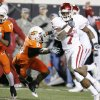 OU\'s Demarco Murray runs for a touchdown past Rickey Price (6) and Jacob Lacey (17) of OSU during the first half of the college football game between the University of Oklahoma Sooners (OU) and Oklahoma State University Cowboys (OSU) at Boone Pickens Stadium on Saturday, Nov. 29, 2008, in Stillwater, Okla. STAFF PHOTO BY CHRIS LANDSBERGER