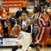 Oklahoma State\'s Tiffany Bias (3) drives against Oklahoma\'s Aaryn Ellenberg (3) during the Bedlam women\'s college basketball game between Oklahoma State University and the University of Oklahoma at Gallagher-Iba Arena in Stillwater, Okla., Saturday, Feb. 23, 2013. OSU beat OU, 83-62. Photo by Nate Billings, The Oklahoman