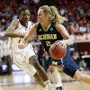Photo -   Michigan guard Courtney Boylan (2) drives around Oklahoma's DeShawn Harden, left, in the second half of an NCAA tournament first-round women's college basketball game in Norman, Okla., Sunday, March 18, 2012. Oklahoma won 88-67. (AP Photo/Sue Ogrocki)