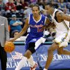 Photo - Los Angeles Clippers guard Shaun Livingston, left, drives past New Orleans/Oklahoma City Hornets forward Rasual Butler, in the first half of an NBA basketball game, Monday, Jan. 8, 2007, in Oklahoma City. (AP Photo/Ty Russell) ORG XMIT: OKTR103