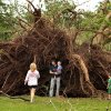 Above: Zach Winters and his son, Leif, 3, stand next to an uprooted tree in Rotary Park at Boyd Street and Wylie Road.