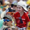 Ezra Terk, 3, and his father, Eugene, listen to Anders Osborne performs on the Gentilly Stage during the New Orleans Jazz Fest in New Orleans Saturday, May 5, 2012. (AP Photo/The Times-Picayune, Brett Duke)