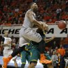 Oklahoma State\'s Marcus Smart (33) is fouled by Rico Gathers (2) during an NCAA college basketball game between Oklahoma State University (OSU) and Baylor at Gallagher-Iba Arena in Stillwater, Okla., Saturday, Feb. 1, 2014. Baylor won 76-70. Photo by Bryan Terry, The Oklahoman