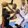 Miami\'s LeBron James (6) tires to get by Oklahoma City\'s Kevin Durant (35) and Oklahoma City\'s Thabo Sefolosha (2) during Game 2 of the NBA Finals between the Oklahoma City Thunder and the Miami Heat at Chesapeake Energy Arena in Oklahoma City, Thursday, June 14, 2012. Photo by Nate Billings, The Oklahoman