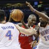 Photo -   Los Angeles Clippers guard Jamal Crawford (11) drives between Oklahoma City Thunder forwards Nick Collison (4) and Kevin Durant (35) in the second quarter of an NBA basketball game in Oklahoma City, Wednesday, Nov. 21, 2012. (AP Photo/Sue Ogrocki)