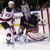 New Jersey Devils\' David Clarkson, left, stands near New York Rangers goalie Henrik Lundqvist during the third period of the NHL hockey game Sunday, April 21, 2013, in New York. The Rangers beat the Devils 4-1. (AP Photo/Seth Wenig)