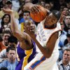 Oklahoma City\'s Kevin Durant (35) tries to keep control of the ball next to Kobe Bryant (24) of Los Angeles during the NBA basketball game between the Los Angeles Lakers and the Oklahoma City Thunder at the Ford Center in Oklahoma City, Friday, March 26, 2010. Oklahoma City won, 91-75. Photo by Nate Billings, The Oklahoman