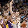 Kobe Bryant of the Lakers passes around Oklahoma City\'s Nick Collison during the NBA basketball game between the Los Angeles Lakers and the Oklahoma City Thunder at the Ford Center,Tuesday, Feb. 24, 2009. PHOTO BY BRYAN TERRY, THE OKLAHOMAN