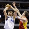 Dallas Mavericks\' Dirk Nowitzki (41), of Germany, shoots past Houston Rockets\' Chandler Parsons (25) in the second half of an NBA basketball game, Wednesday, March 6, 2013, in Dallas. Nowitzki had 22-points in their 112-108 win. (AP Photo/Tony Gutierrez)