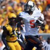 Oklahoma State receiver Josh Stewart (5) runs for 73-yards for a touchdown reception during the first quarter of an NCAA college football game against West Virginia in Morgantown, W.Va., on Saturday, Sept. 28, 2013. (AP Photo/Tyler Evert) ORG XMIT: WVTE105