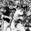 University of Oklahoma defenseman Rick Bryan (80) closes in on Oklahoma State University quarterback John Doerner (5) during Bedlam college football action in Norman, Okla., on Nov. 29, 1980. The OU Sooners defeated the OSU Cowboys, 63-14. Staff photo by Jim Argo