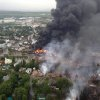 This aerial photo shows a fire in the town of Lac-Megantic as seen from a Sûreté du Québec helicopter Saturday, July 6, 2013 following a train derailment that sparked several explosions in Lac Megantic, Quebec. (AP Photo/Sûreté du Québec via The Canadian Press)