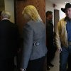 Country music star Garth Brooks, right, walks into a Rogers County Courthouse courtroom in Tulsa, Okla. with his wife Trisha Yearwood, center, and attorney John Hickey, on Tuesday, Jan. 17, 2012. Brooks appeared before the jurors who will hear his claim that an Oklahoma hospital refused to name a building for his late mother after he gave it $500,000. (AP Photo/The Tulsa World, Cory Young) ONLINE OUT; TV OUT; TULSA OUT