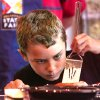 James McAffrey, 9, carefully places a spatula around the edges of a pancake as he prepares to flip his custom creation of Boston Cream Pie Pancakes while competing in the Shawnee Mills\' Kids\' Pancakes, Flapjacks and Griddle Cakes Contest at the Oklahoma State Fair on Saturday, Sep. 22, 2012. The event was held in the Creative Arts Building. McAffrey of Oklahoma City, is home-schooled. Photo by Jim Beckel, The Oklahoman.
