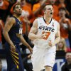 Oklahoma State\'s Phil Forte (13) reacts in front of West Virginia\'s Gary Browne (14) after hitting a 3-point shot during an NCAA college basketball game in Stillwater, Okla., Saturday, Jan. 26, 2013. (AP Photo/The Oklahoman, Nate Billings)