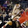 Milwaukee Bucks\' Ersan Ilyasova, left, steals the ball from Philadelphia 76ers\' Jrue Holiday, right, in the second half of an NBA basketball game, Tuesday, Jan. 22, 2013, in Milwaukee. (AP Photo/Jeffrey Phelps)