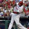 Photo - Philadelphia Phillies' Ryan Howard connects for a home run in the first inning of a baseball game against the Washington Nationals, Saturday, May 3, 2014, in Philadelphia. (AP Photo/Laurence Kesterson)