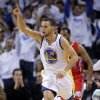 Photo - Golden State Warriors' Stephen Curry (30) celebrates after making a 3-pointer against the Los Angeles Clippers during the first half of an NBA basketball game in Oakland, Calif., Wednesday, Jan. 2, 2013. (AP Photo/Marcio Jose Sanchez)