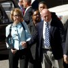 Photo -   Former Democratic Rep. Gabrielle Giffords, left, and her husband Mark Kelly leave after the sentencing of Jared Loughner, in back of U.S. District Court Thursday, Nov. 8, 2012, in Tucson, Ariz. U.S. District Judge Larry Burns sentenced Jared Lee Loughner, 24, to life in prison, for the January 2011 attack that left six people dead and Giffords and others wounded. Loughner pleaded guilty to federal charges under an agreement that guarantees he will spend the rest of his life in prison without the possibility of parole. (AP Photo/Ross D. Franklin)