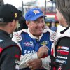 Ken Schrader talks with fellow racers after winning his qualifying race and setting the fastest time in qualifying for the NASCAR Truck Series auto race Wednesday, July 24, 2013, on the dirt at Eldora Speedway in Rossburg, Ohio. (AP Photo/Dayton Daily News, Greg Lynch) LOCAL PRINT OUT AND LOCAL TV OUT (WKEF, WRGT, WDTN)