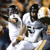 Photo - Vanderbilt quarterback Austyn Carta-Samuels (6) passes against Tennessee in the first quarter of an NCAA college football game on Saturday, Nov. 23, 2013, in Knoxville, Tenn. (AP Photo/Mark Zaleski)