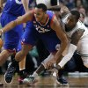 Philadelphia 76ers\' Evan Turner (12) and Boston Celtics\' Rajon Rondo, right, scramble for a loose ball in the second quarter of an NBA basketball game in Boston, Friday, Nov. 9, 2012. (AP Photo/Michael Dwyer)
