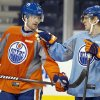 Edmonton Oilers\' Nick Schultz, left, and Ales Hemsky discuss a drill during their NHL hockey training camp in Edmonton, Alberta, Monday, Jan. 14, 2013. (AP Photo/The Canadian Press, Jason Franson)