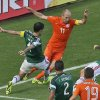 Photo - Mexico's Rafael Marquez, left, fouls Netherlands' Arjen Robben inside the penalty box during the World Cup round of 16 soccer match between the Netherlands and Mexico at the Arena Castelao in Fortaleza, Brazil, Sunday, June 29, 2014. (AP Photo/Themba Hadebe)