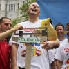Joey Chestnut laughs as he stands on the scale during the official weigh-in for the Nathan\'s Fourth of July hot dog eating contest, Wednesday, July 3, 2013 at City Hall park in New York. (AP Photo/Mary Altaffer)