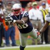 New England Patriots tight end Daniel Fells (86) cannot hold on to a pass as Miami Dolphins strong safety Chris Clemons (30) defends during the first half of an NFL football game on Sunday, Dec. 2, 2012, in Miami. (AP Photo/John Bazemore)
