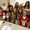 Sooner cheer squad members pose with quarterbacks Blake Bell,left, and Trevor Knight during fan appreciation day for the University of Oklahoma Sooner (OU) football team at Gaylord Family-Oklahoma Memorial Stadium in Norman, Okla., on Saturday, Aug. 3, 2013. Photo by Steve Sisney, The Oklahoman