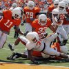 OSU\'s Jeremy Smith (31) rushes for a touchdown in front of Shaun Lewis (11), Andrew Smith (79), LeRon Furr (33) and Isaiah Anderson (82) during the Orange/White spring football game for the Oklahoma State University Cowboys at Boone Pickens Stadium in Stillwater, Okla., Saturday, April 16, 2011. Photo by Nate Billings, The Oklahoman