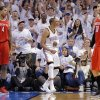 Oklahoma City\'s Russell Westbrook (0) reacts after making a shot in front of Houston\'s Greg Smith (4) and Carlos Delfino (10) during Game 2 in the first round of the NBA playoffs between the Oklahoma City Thunder and the Houston Rockets at Chesapeake Energy Arena in Oklahoma City, Wednesday, April 24, 2013. Photo by Chris Landsberger, The Oklahoman