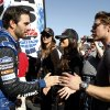 Jimmie Johnson, left, shakes hands and talks with actors Josh Henderson, right, Jordana Brewster, second from right, and Julie Gonzalo, third from left, of the television show